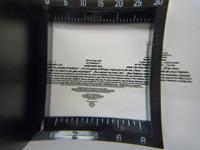 Die Mikroschrift unter dem Fadenzähler