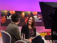 Nachuchsmoderatorin Laura Terberl im Gespräch mit Ihrem Gast auf dem Podium (© imo)