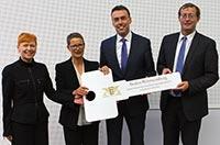 Sybille Müller, Annette Ipach-Öhmann, Minister Dr. Nils Schmid und HdM-Rektor Prof. Dr. Alexander W. Roos (von links)