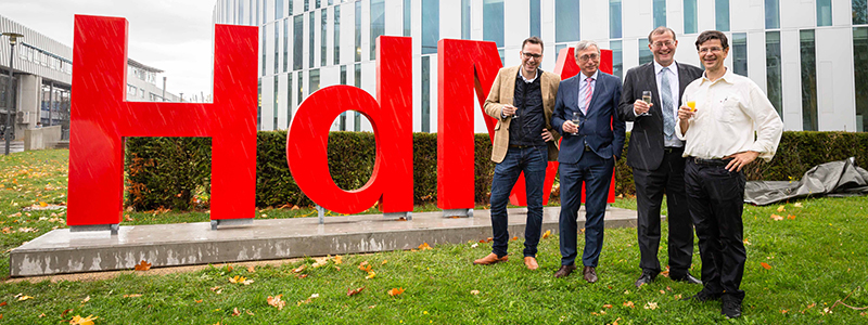 Prof. Dr. Bernhard Dusch, Peter Marquardt, Prof. Dr. Alexander W. Roos, rector at HdM, and Prof. Dr. Andreas Koch (from left to right) infront of the new letters, Foto: Florian Müller